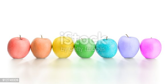 istock Row of different rainbow colored apples isolated with clipping path 912745326