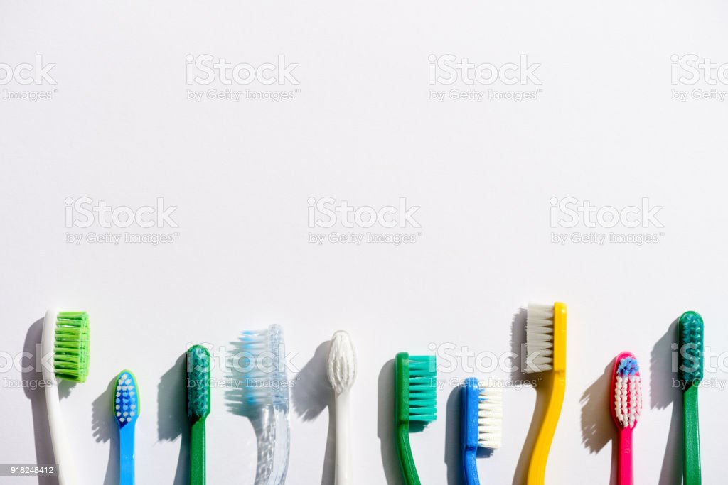 row of different toothbrushes, on white with copy space stock photo