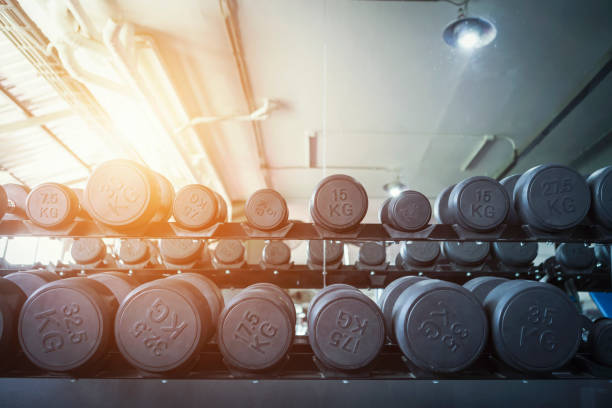 Row of dumbbells in sport club. Exercise in gym for healthy concept. Row of dumbbells in sport club. Exercise in gym for healthy concept. weights stock pictures, royalty-free photos & images