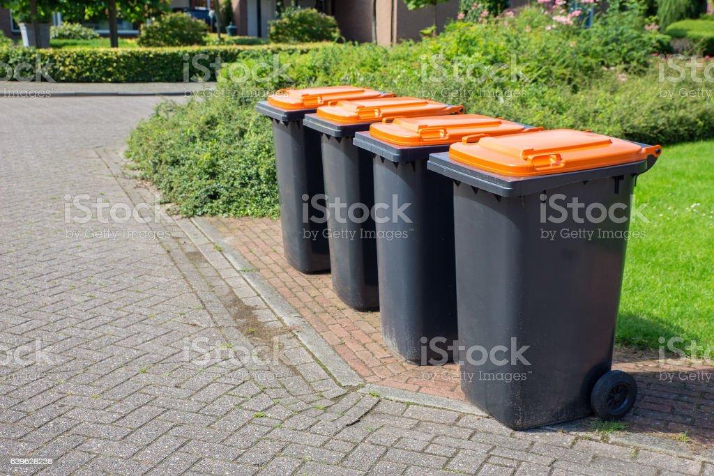 Row of dutch grey waste bins along street royalty-free stock photo