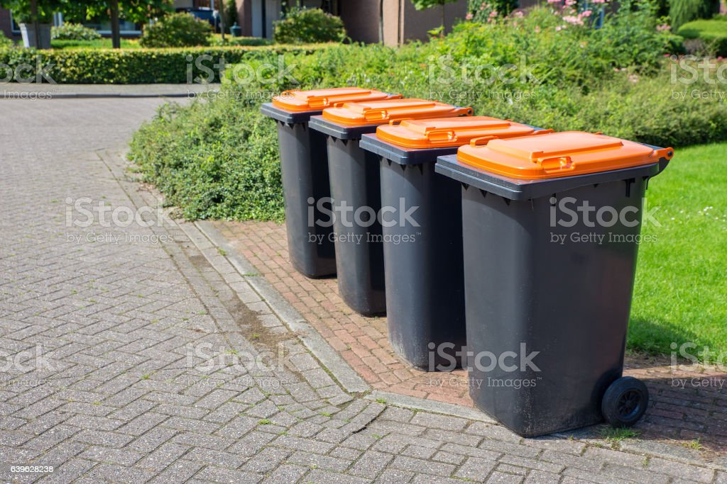 Row of dutch grey waste bins along street - foto de stock