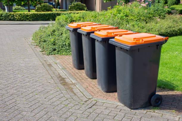 Row of dutch grey waste bins along street stock photo