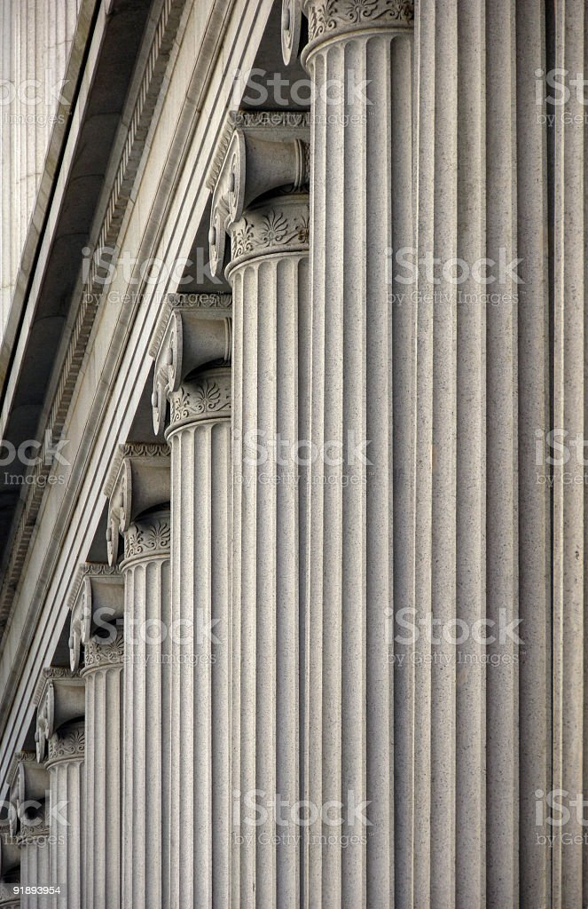 A row of elaborate stone columns stock photo