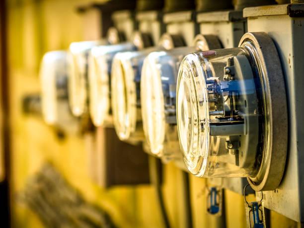 row of electric meters array - rete elettrica foto e immagini stock