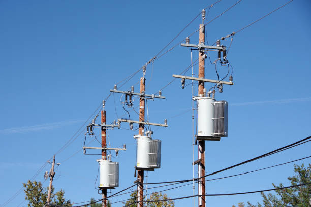 Row of electricity poles stock photo