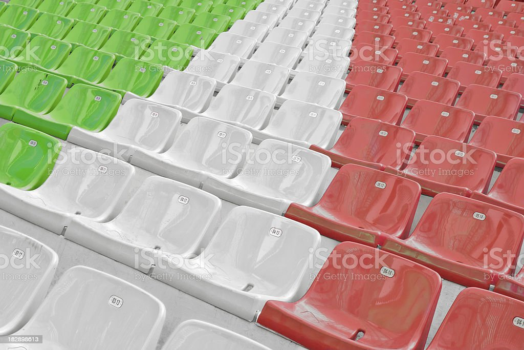 Row of empty plastic chairs with italian flag colors royalty-free stock photo