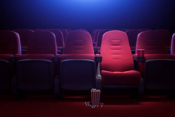 Row of empty red cinema seats
