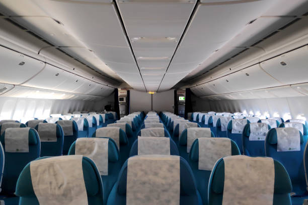 Row of empty seats in a Boeing 777 stock photo