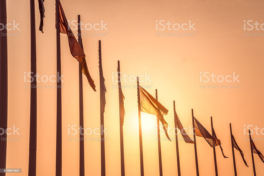 Row of european flags against sunset stock photo