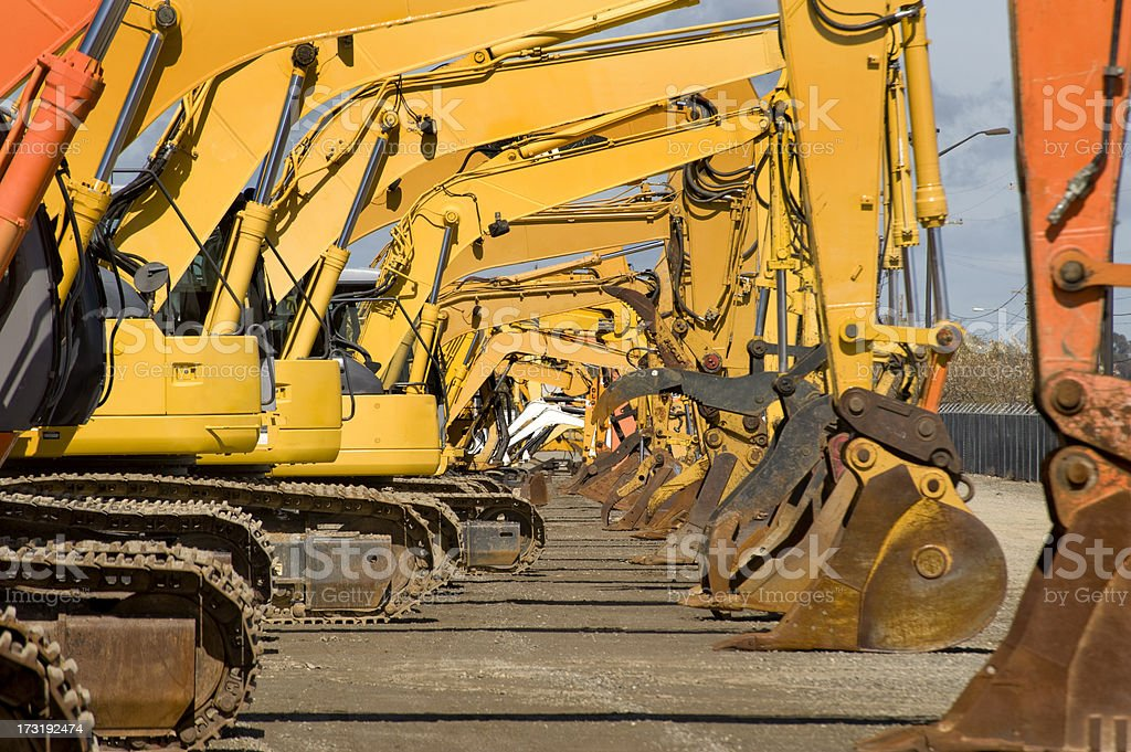 Row of excavators at work site stock photo