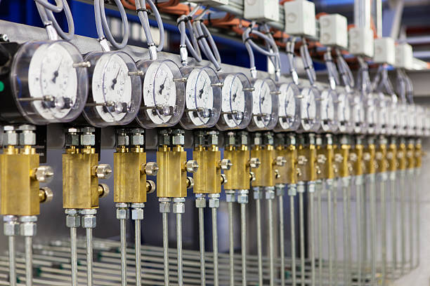Row of factory gauges and pipes stock photo