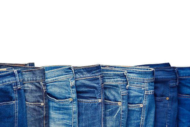 Row of fashion different jeans isolated on white. – Foto