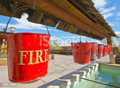 A row of fire buckets above a water tank in the ghost town of Valico Eastern California.
