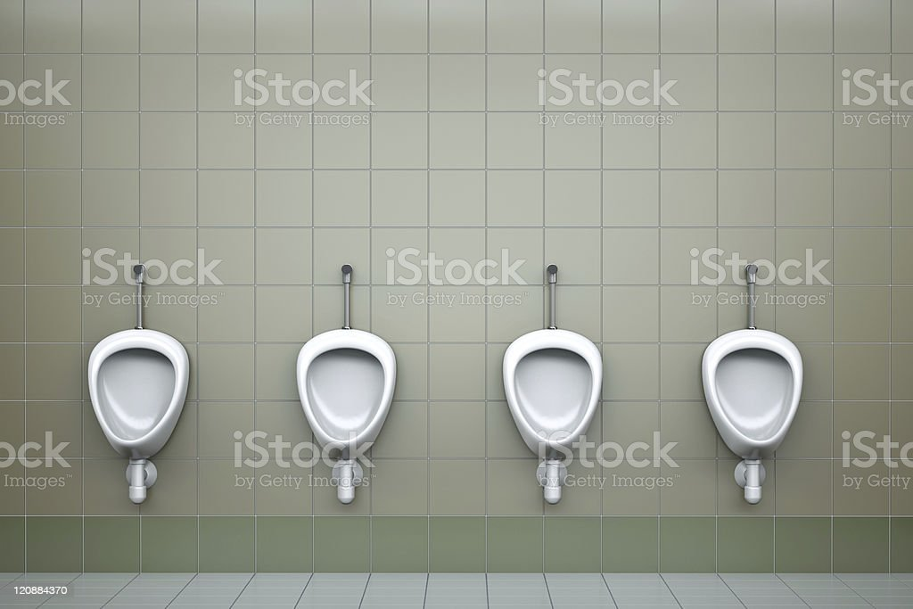 Row of four urinals in a public toilet stock photo