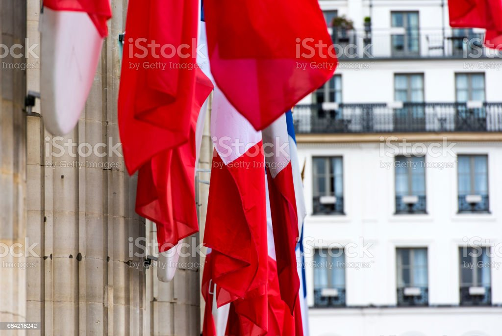 Row of French flags on columns of Pantheon in Paris royalty-free stock photo