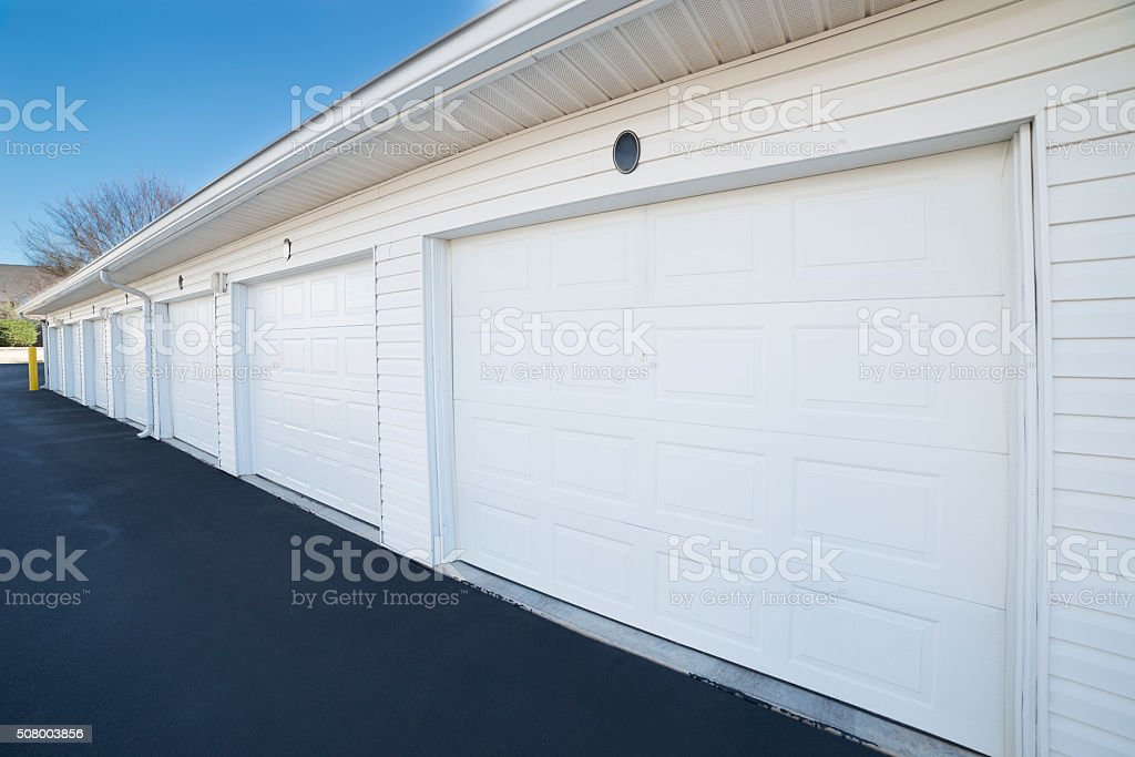 Row of Garage Doors for Apartment Homes stock photo