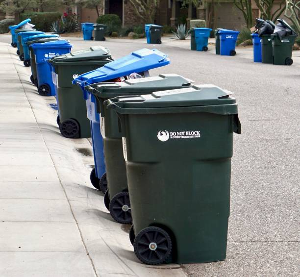 row of garbage and recycling bins stock photo