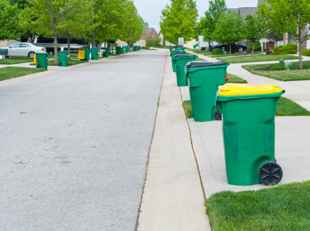 Row of garbage bins lined up along the roadside stock photo
