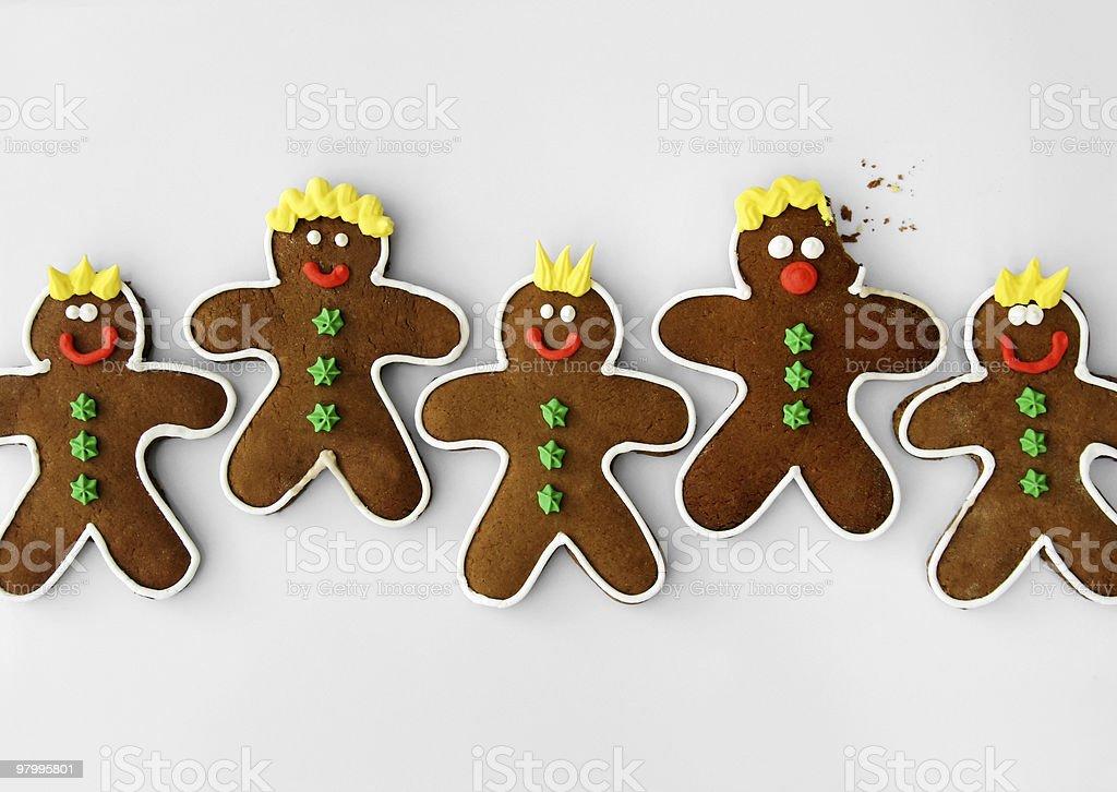 Row of gingerbread men, one has been bitten royalty-free stock photo
