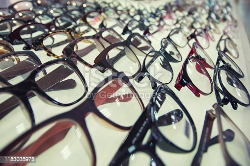 Row of glasses at an opticians. Eyeglasses shop.
