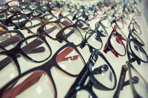 Row of glasses at an opticians. Eyeglasses shop. stock photo