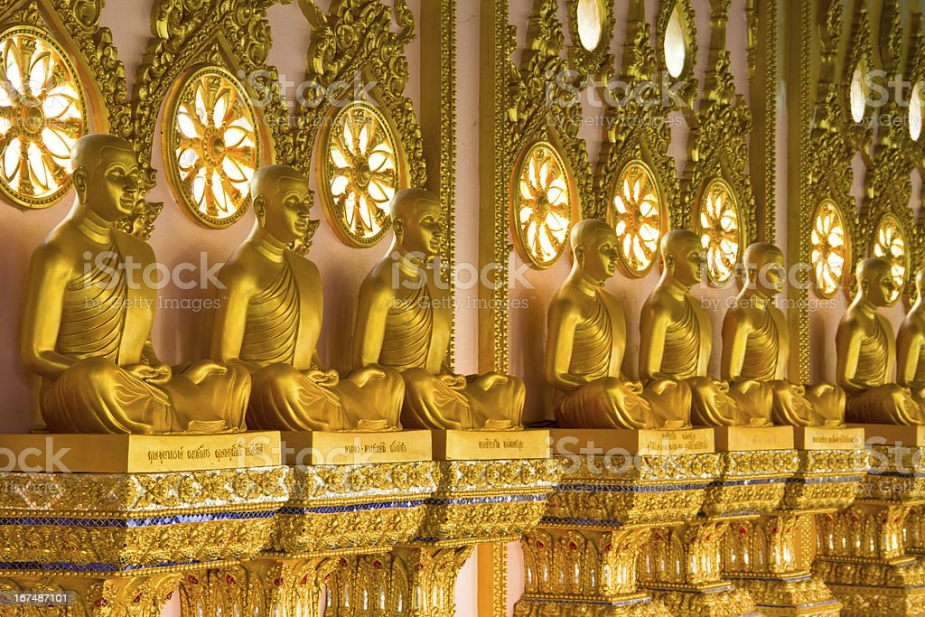 Row of gold monk statue royalty-free stock photo