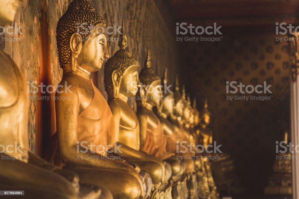 Row of golden buddha statue at Wat Arun, Bangkok Thailand. Landmark of Thailand and asia stock photo