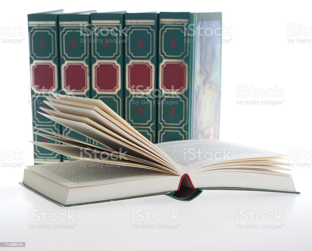Row of green books, one book open in front royalty-free stock photo