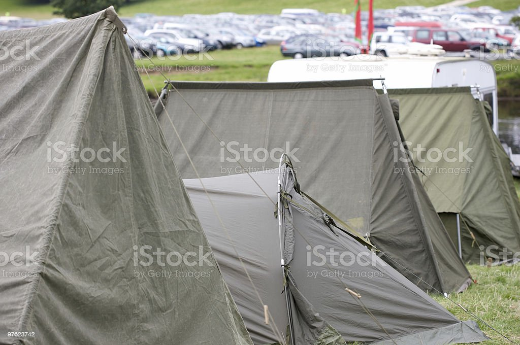 Row of Green camouflage military tents royalty-free stock photo