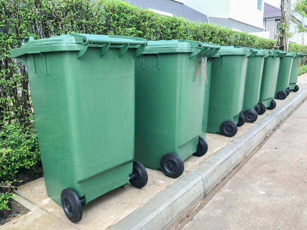 row of green plastic bin stock photo