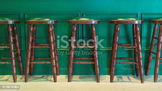 istock Row of green wooden stools 515675084