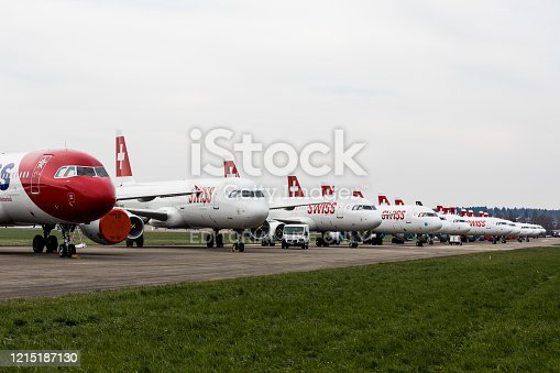 Dübendorf, Switzerland - March 26, 2020: Grounded Swiss and Edelweiss Airbus A320/321 airplane line-up in a neat row at Militärflugpatz Dübendorf. The coronavirus crisis is hitting the airlines hard.