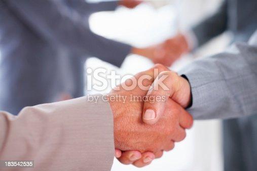 istock Row of handshake 183542535