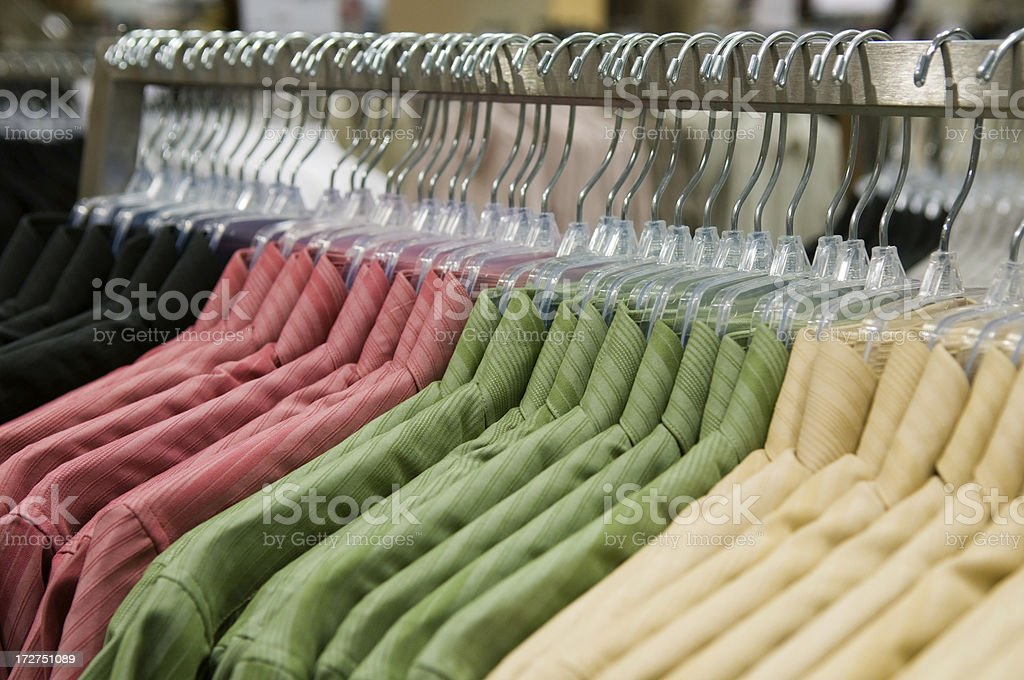 Row of Hanging Shirts on a Rack royalty-free stock photo
