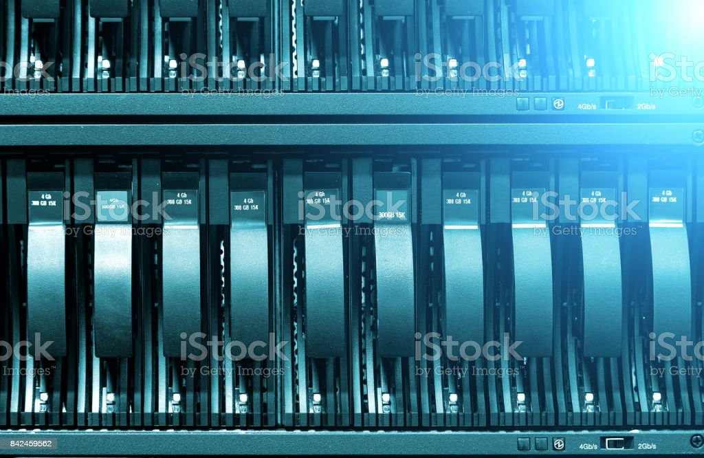 Row of hard disks close-up with ligh. The concept of information technology . stock photo