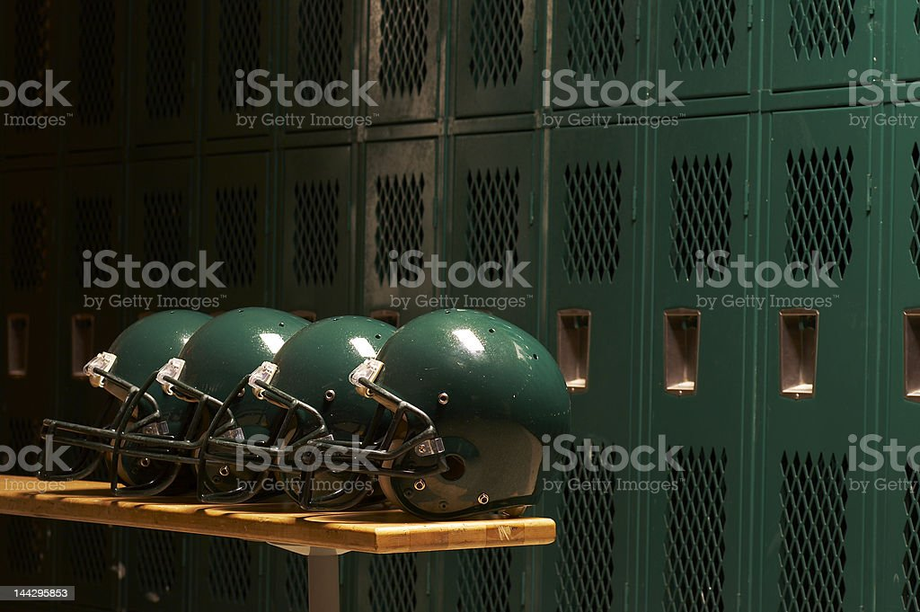 row of helmets stock photo