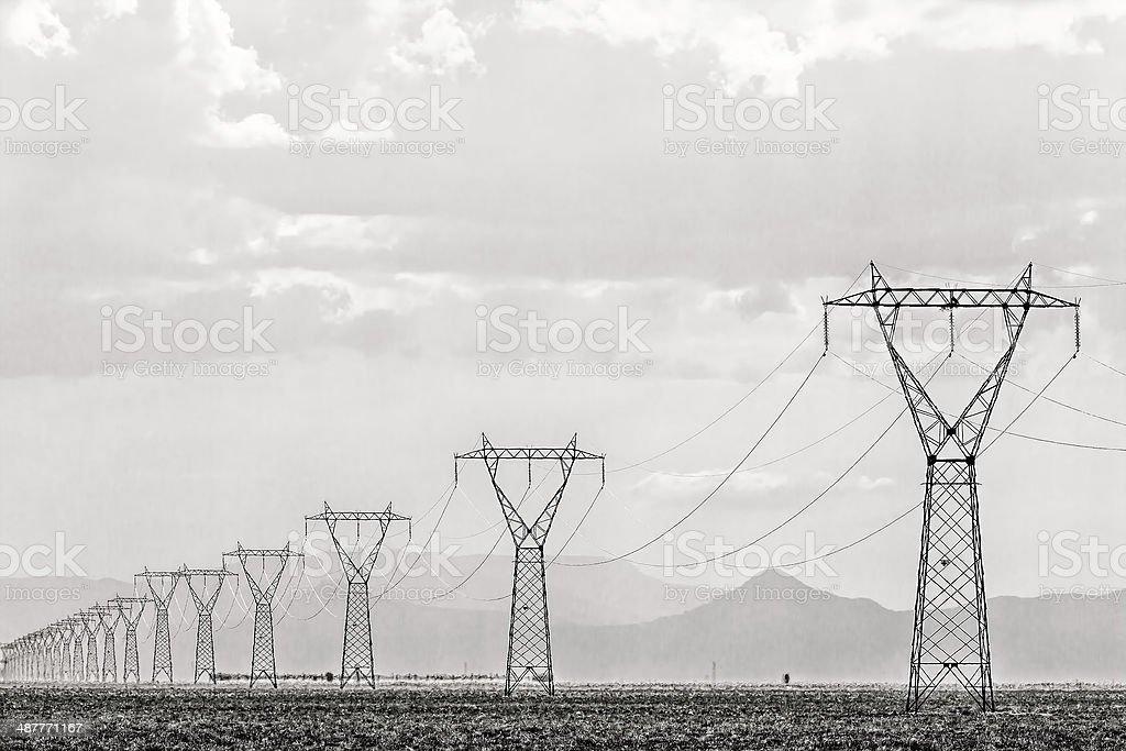 Row of high voltage masts stock photo