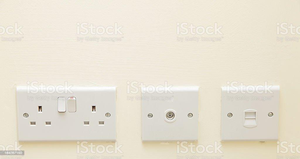 row of household sockets stock photo
