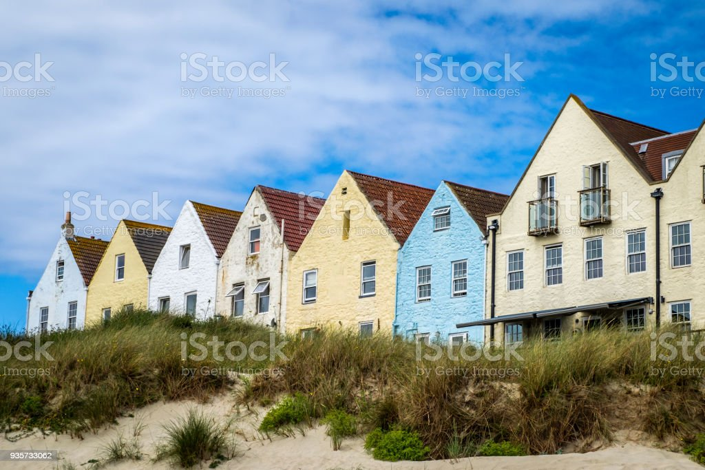 Row of houses and at Braye Beach, Alderney, Guernsey, Channel Islands stock photo