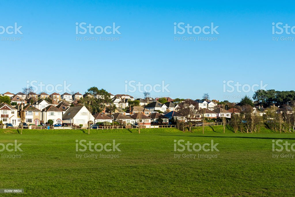 Row of houses by a park stock photo