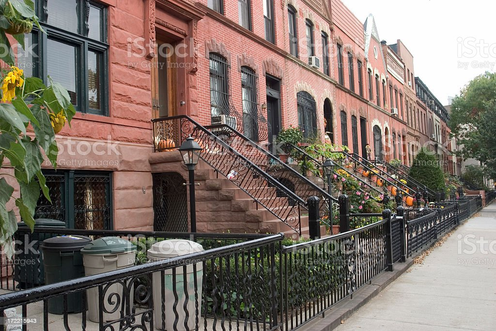 Row of houses with staircase in quiet neighborhood royalty-free stock photo