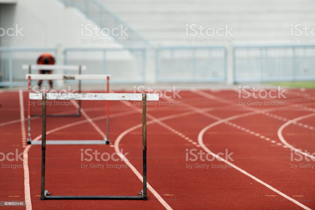 Row of hurdles for a track and field sprint hurdle race. stock photo