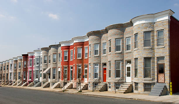 row of identical houses on a street - terraced houses stock photos and pictures