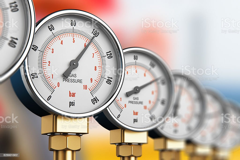 Row of industrial high pressure gas gauge meters stock photo