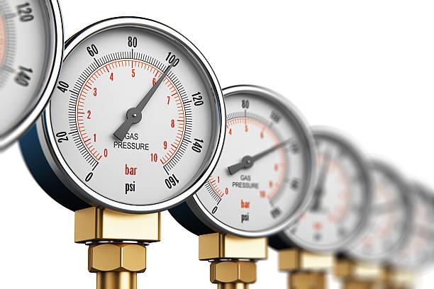 Row of industrial high pressure gas gauge meters stock photo