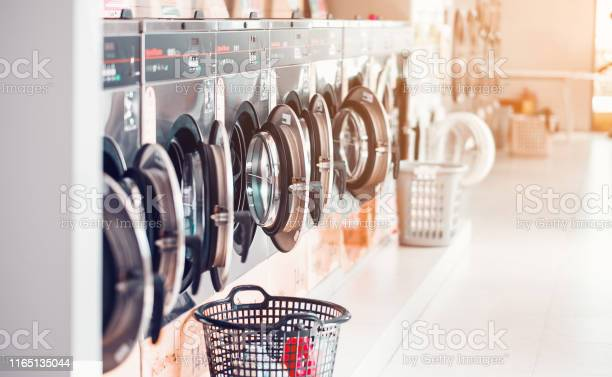 Row of industrial laundry machines in laundromat in a public with picture id1165135044?b=1&k=6&m=1165135044&s=612x612&h=jz5fha5xduslcethbfw16gbe8p 3wh5nwcycyur3yim=