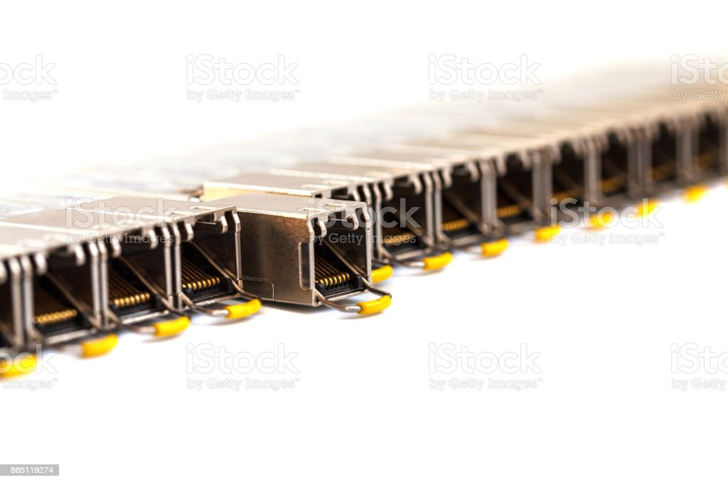 Row of Internet SFP (Small Form-factor Pluggable)  network modules for network switch. Close up. Isolated. stock photo