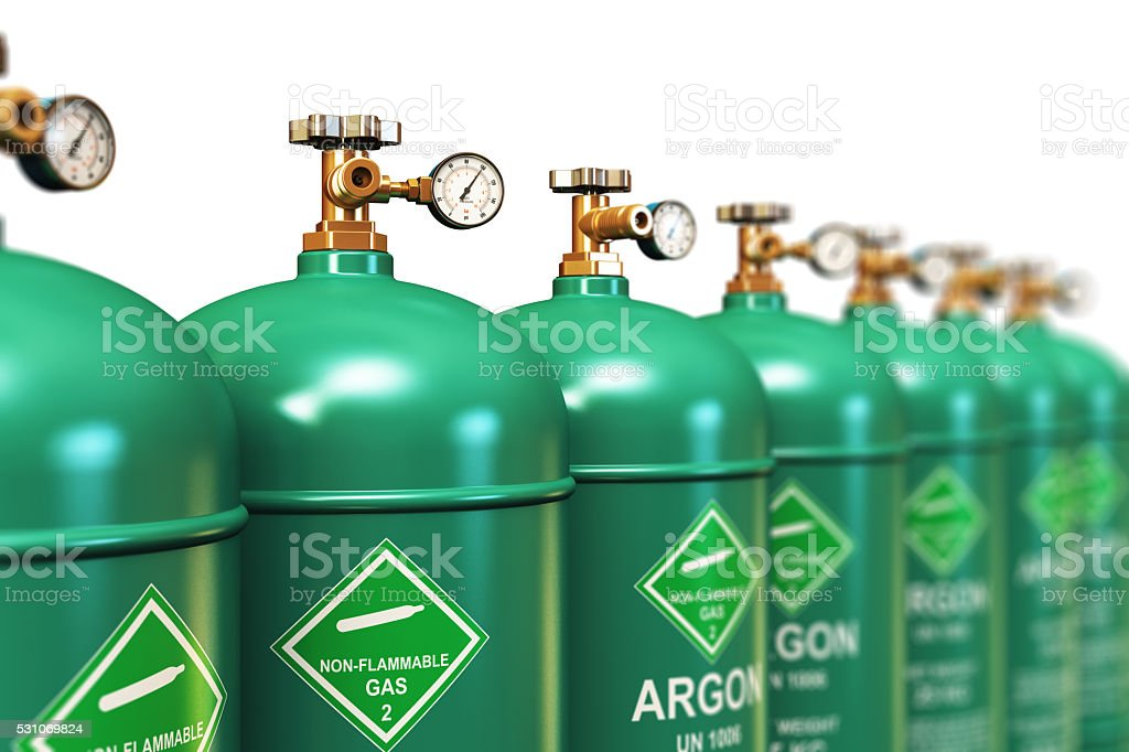 Row of liquefied argon industrial gas containers stock photo