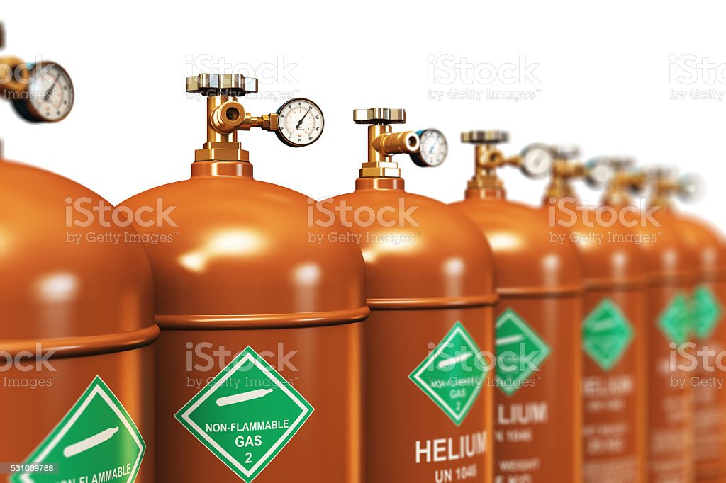Row of liquefied helium industrial gas containers stock photo