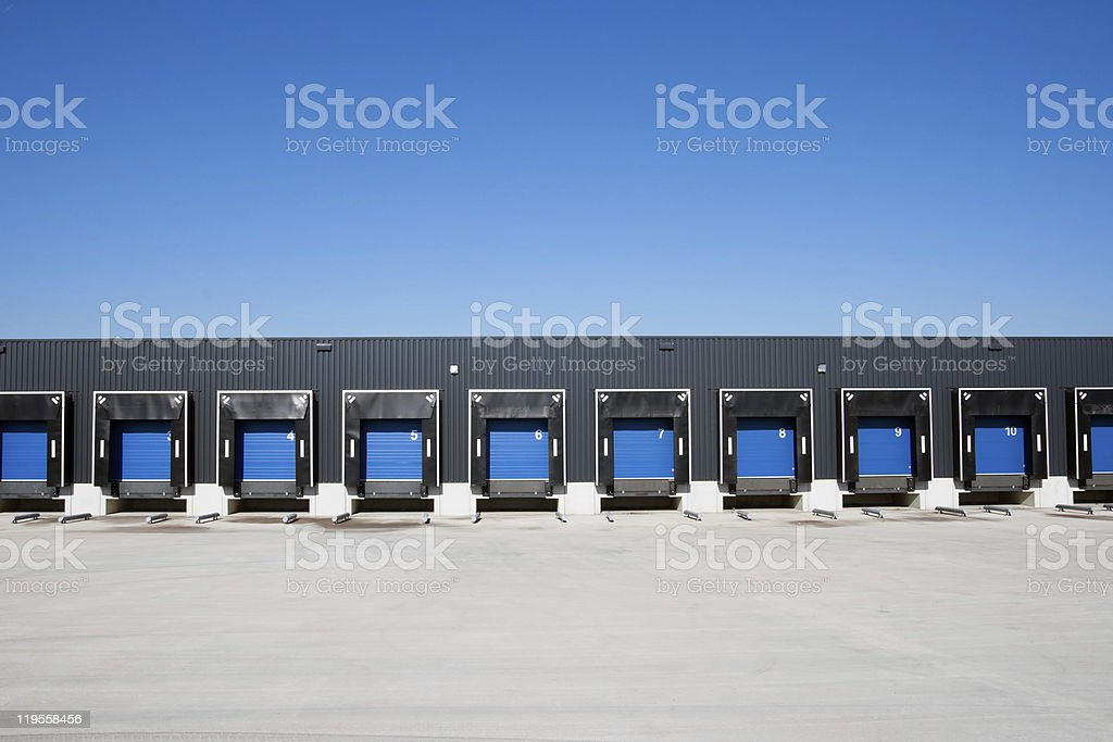 Row of loading blue dock entrances against blue sky royalty-free stock photo